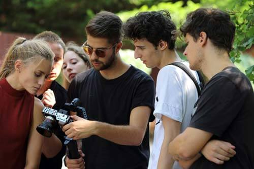 BFA students checking recorded footage on set
