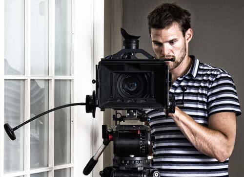 Cinematography student handling a camera