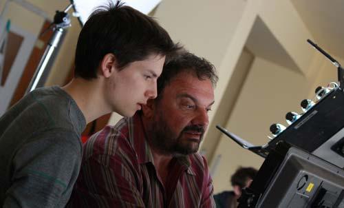 Jenő Hódi with a student on set